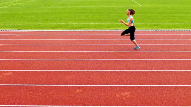 vídeos de stock e filmes b-roll de young sportswoman training on running track slow motion video - the end
