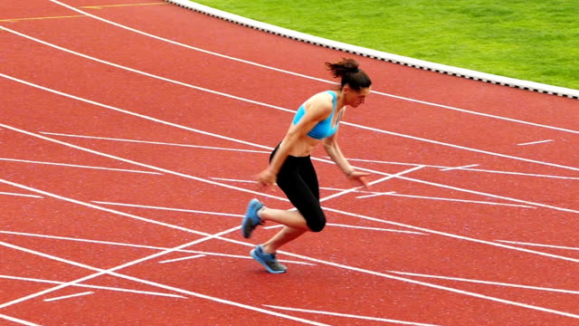 young sportswoman training on running track slow motion video - finishing stock videos & royalty-free footage