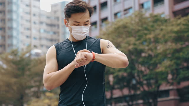 young sporty man checking he smart watch - taiwan stock videos & royalty-free footage
