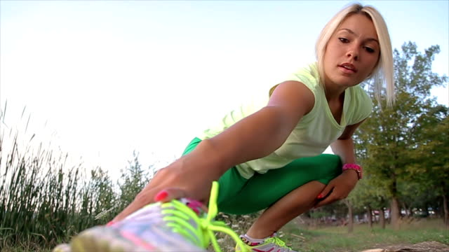 Young sporty woman doing fitness exercise