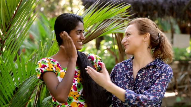 young sri lankan woman chatting with a caucasian woman - tourist stock videos & royalty-free footage