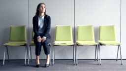 Young stressful woman waiting for job interview