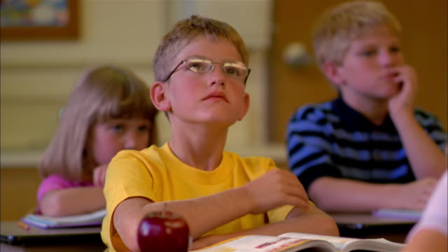 a young student daydreams during class. - boredom stock videos & royalty-free footage