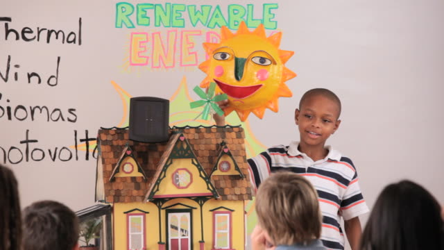 Young Student Giving Presentation on Renewable Energy to Class in School / Richmond, Virginia, USA