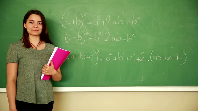Young student in front of board