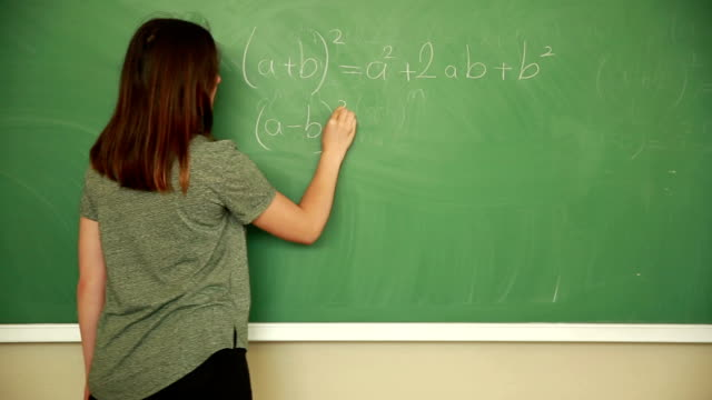 young student writing math formula - mathematics stock videos and b-roll footage