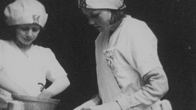 montage young students in school working on household and shop tasks / united kingdom - 1931年点の映像素材/bロール