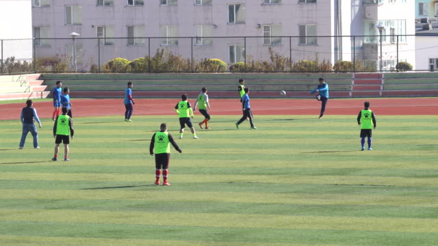Young students in Yanbian University are playing a football match on the campus pitch China unveiled a plan to transform China into a soccer...