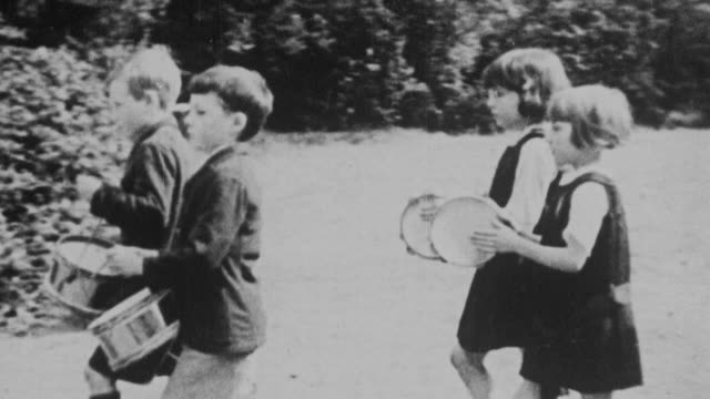 montage young students playing instruments and marching in the school yard / united kingdom - 1931 stock videos & royalty-free footage