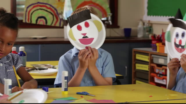 pan young students playing with paper plate art projects / great yarmouth, england, united kingdom - paper plate stock videos & royalty-free footage
