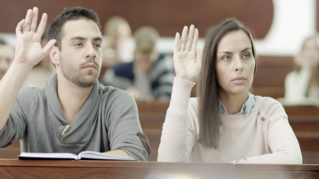 young students raising hand - seminar stock videos & royalty-free footage