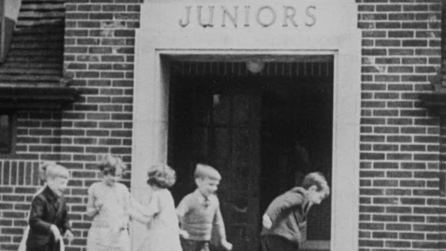 montage young students running from school into the playground and playing various games in the yard / united kingdom - 1931 stock videos & royalty-free footage