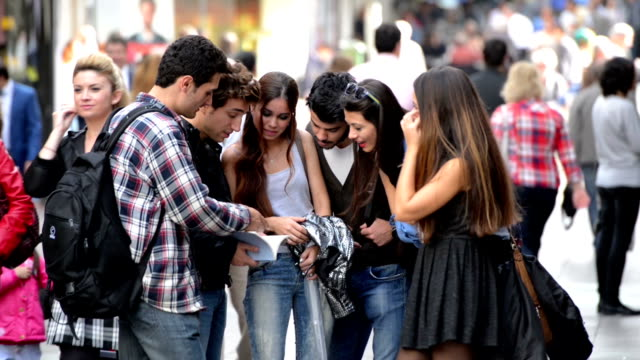 young students talking on a busy street - lifestyles stock videos & royalty-free footage