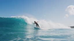 Young surfer ripping gnarly turn