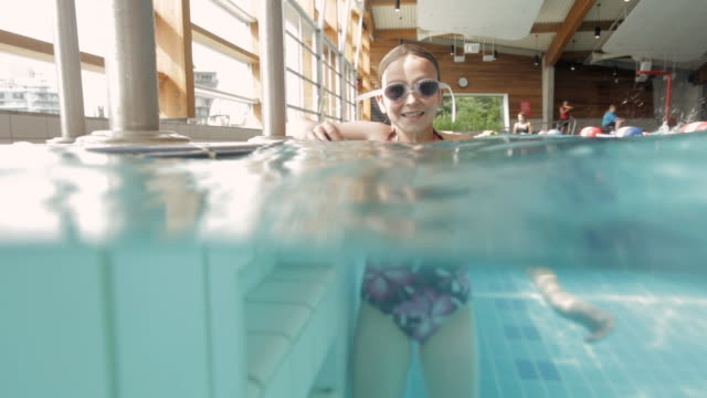 ms young swimmer swimming in pool / vancouver, british columbia, canada - one piece swimsuit stock videos and b-roll footage