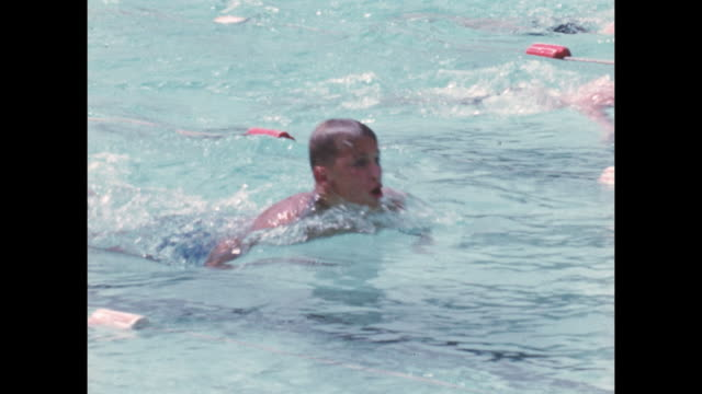 Young swimmers compete in a swimming race.