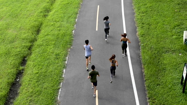 young team jogging on city bridge - five people stock videos & royalty-free footage