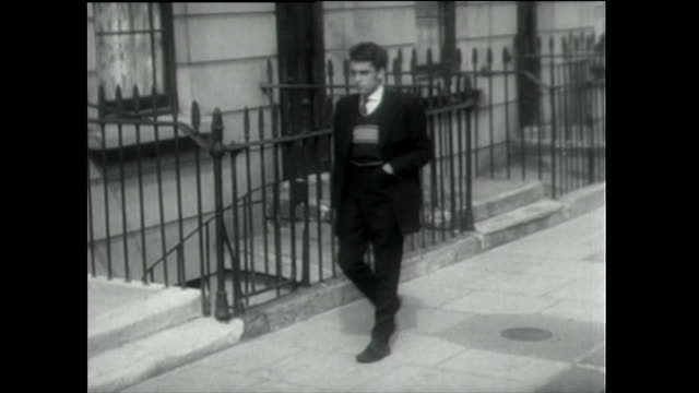 young teddy boy walks down residential street; 1955 - 1955 stock videos & royalty-free footage