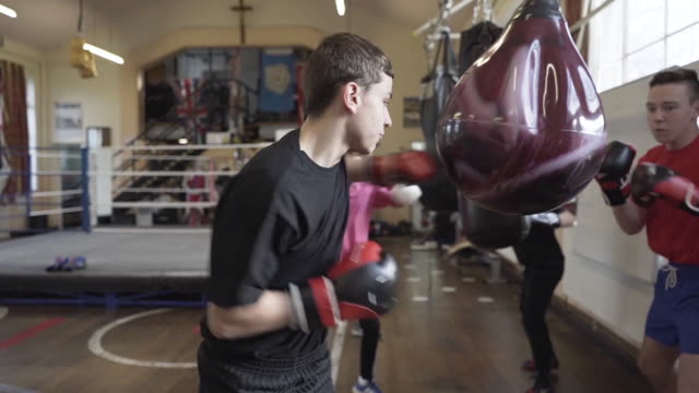 young teenage boys training at a boxing club - punch bag stock videos & royalty-free footage