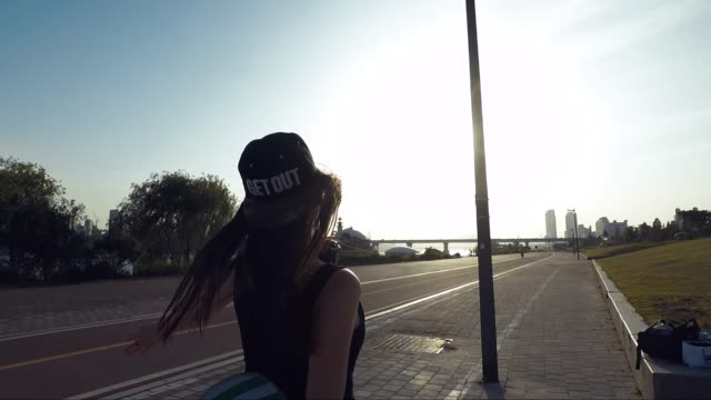 young teenage girl with skateboard having fun in the city - hipster culture stock videos & royalty-free footage