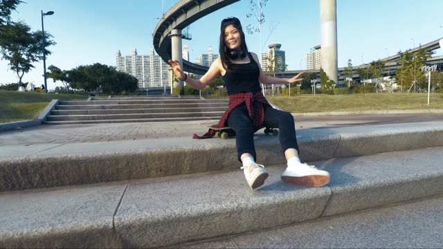young teenage girl with skateboard having fun in the city - skateboard park stock videos & royalty-free footage