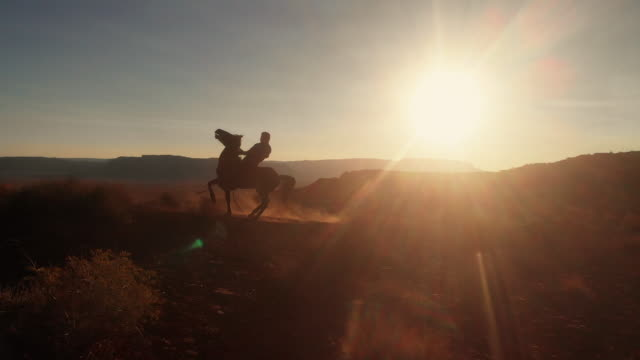 young teenage native american navajo boy riding his horse bareback in the navajo reservation near monument valley tribal park in northern arizona at dusk in the summer - grand canyon stock videos & royalty-free footage