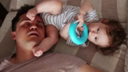 Young tired father sleep