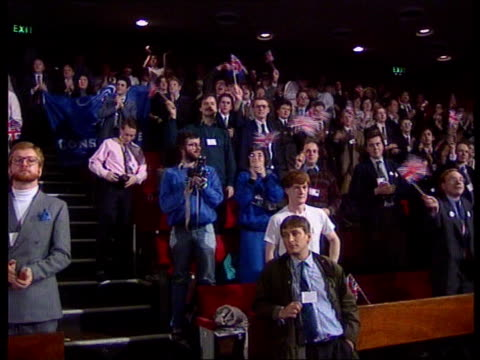 young tory conference england sussex eastbourne bv young tories standing waving and cheering some waving small union jack flags ms smiling pm john... - philosophy stock videos & royalty-free footage
