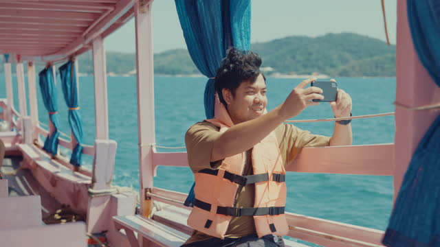 young tourist enjoying sea view while transportation. - photographing stock videos & royalty-free footage