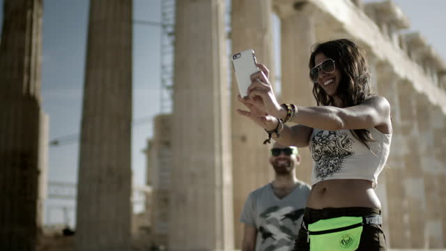 young tourists pose for photos in athens - using phone stock videos & royalty-free footage