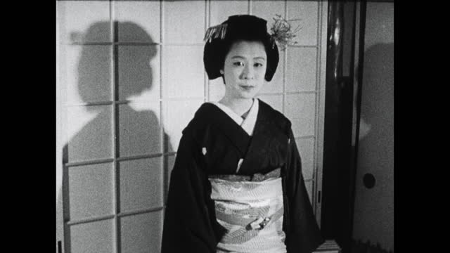 young trainee geisha turns on spot in kimono; 1964 - bbc archive stock-videos und b-roll-filmmaterial
