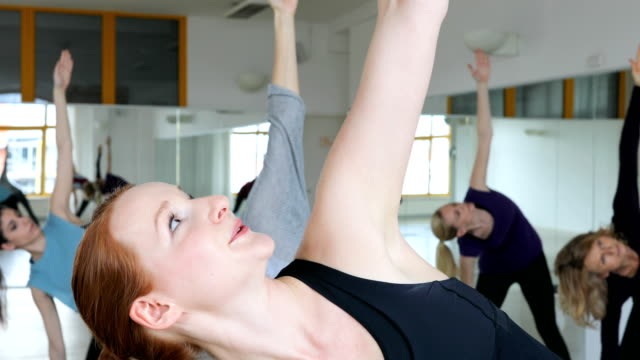 young trainer instructing females in yoga class - 40 49 years stock videos & royalty-free footage