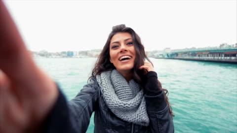 young turkish girl taking selfies near galata bridge - turkish ethnicity stock videos & royalty-free footage