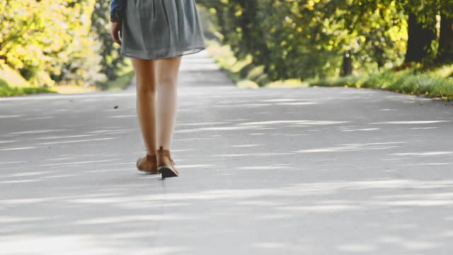 ds young unrecognizable girl walking down the road - skirt stock videos & royalty-free footage