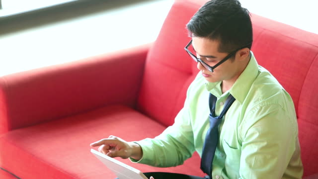 Young Vietnamese businessman using digital tablet