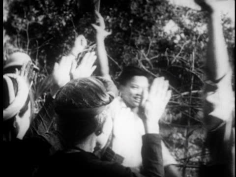 stockvideo's en b-roll-footage met young vietnamese men packing their things and joyfully going to join the army / mothers wave at the boys as they march off / new soldiers being... - strohoed