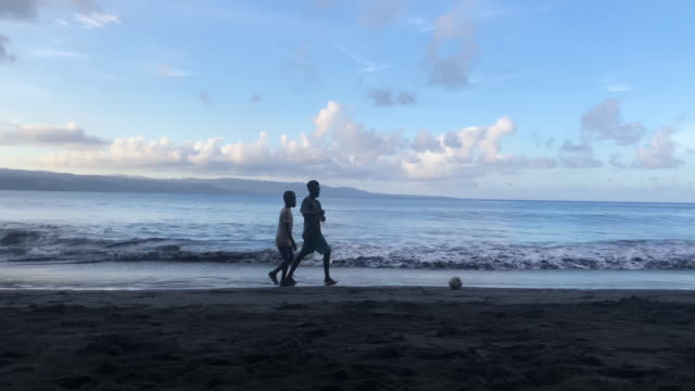 young villagers play soccer on the black sand beach on december 03 2019 in tanna vanuatu 25 percent of vanuatu's 276000 citizens lost their homes in... - south pacific ocean stock videos & royalty-free footage
