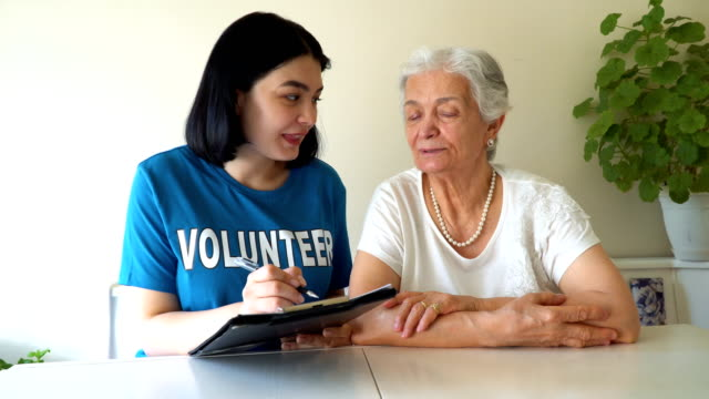 young volunteer making a list for aged lady - to do list stock videos & royalty-free footage