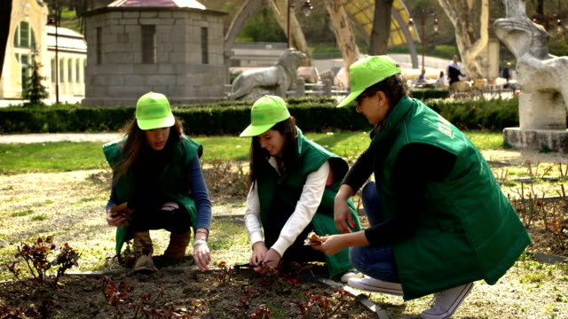 young volunteers clean the park-a positive example for all people on the Earth