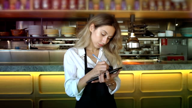 young waitress taking order in cafe or restaurant - menu stock videos & royalty-free footage