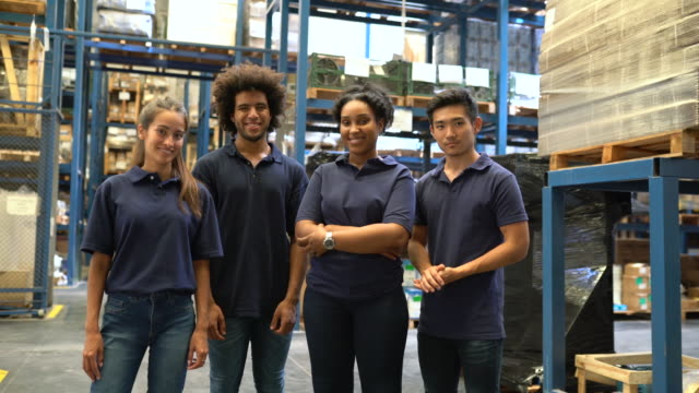 young warehouse team standing in factory - multi ethnic group stock videos & royalty-free footage