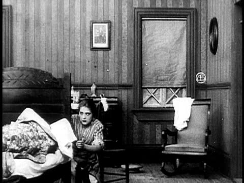 1910 b&w young washer woman sneaking into boss's bedroom and stealing money/ usa - 1910 stock-videos und b-roll-filmmaterial