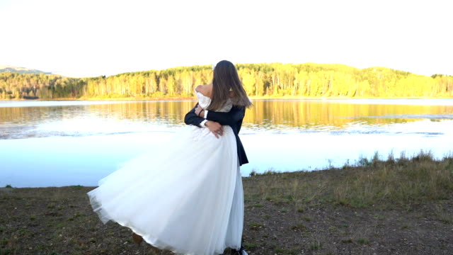 young wedding couple have romance on sunset - dress stock videos & royalty-free footage