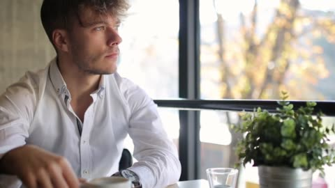 young, well dressed, drinking coffee and looking through the window, while sitting in coffee bar - joy stock videos & royalty-free footage