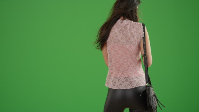 'young white girl calls a ride share on green screen - bluse stock-videos und b-roll-filmmaterial