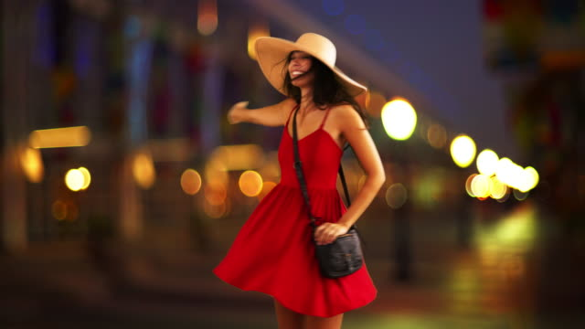 young white girl dancing downtown in her red sundress and floppy hat - sommerkleid stock-videos und b-roll-filmmaterial