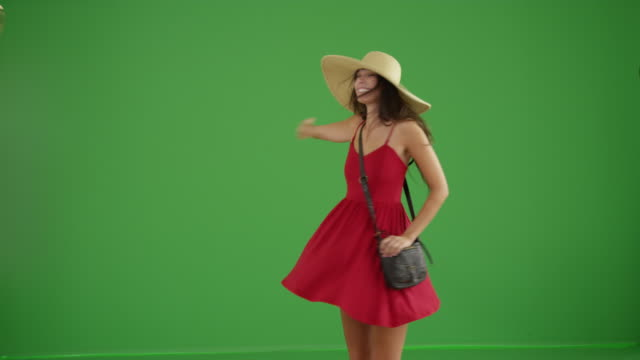 young white girl dancing in her red sundress and floppy hat on green screen - apparato digerente umano video stock e b–roll