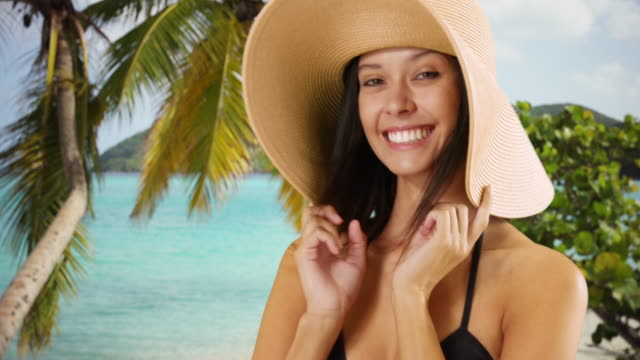 young white girl in a sun hat poses for a portrait on a caribbean beach - sun hat stock videos & royalty-free footage