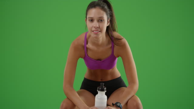 young white girl rests after a work out on green screen - apparato digerente umano video stock e b–roll