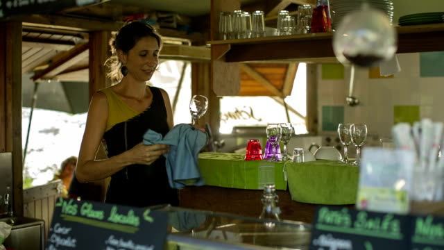 A young white waitress  in a typical Caribbean restaurant